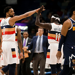 Jan 30, 2019; New Orleans, LA, USA; New Orleans Pelicans center Jahlil Okafor (8) reacts after a basket with guard Jrue Holiday (11) during the first quarter against the Denver Nuggets at the Smoothie King Center. Mandatory Credit: Derick E. Hingle-USA TODAY Sports