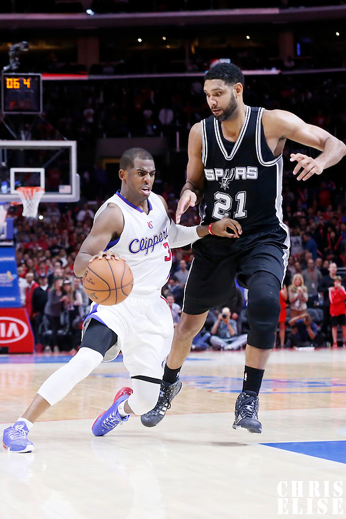 10 November 2014: Los Angeles Clippers guard Chris Paul (3) drives past San Antonio Spurs forward Tim Duncan (21) during the San Antonio Spurs 89-85 victory over the Los Angeles Clippers, at the Staples Center, Los Angeles, California, USA.