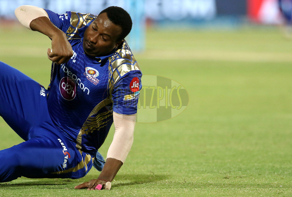 Kieron Pollard of the Mumbai Indians takes the catch of Gujarat Lions captain Suresh Raina during match 35 of the Vivo 2017 Indian Premier League between the Gujarat Lions and the Mumbai Indians  held at the Saurashtra Cricket Association Stadium in Rajkot, India on the 29th April 2017<br /> <br /> Photo by Vipin Pawar - Sportzpics - IPL