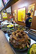 Malaysia, Kuala Lumpur. Central Market. Crispy fried fish.