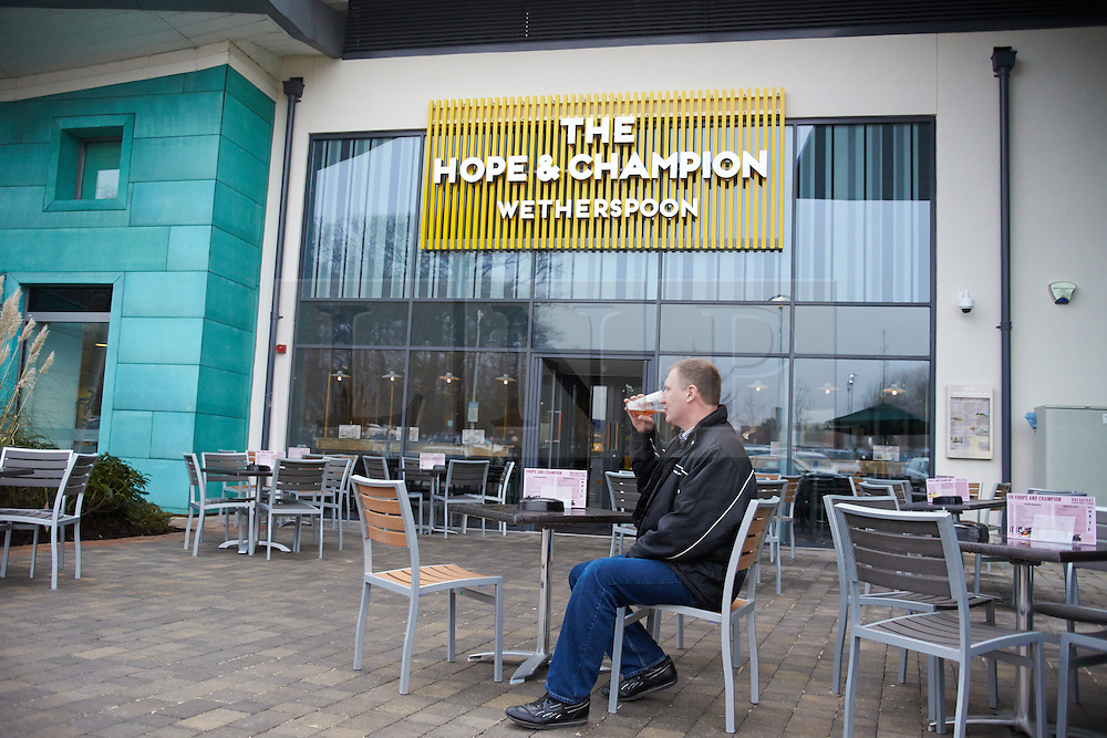 © Licensed to London News Pictures.  21/01/2014. BEACONSFIELD, UK. Brian Russell drinks a pint at the Hope & Champion pub, operated by Wetherspoons, in the Beaconsfield service station next to the M40. He has visited 300 different Wetherspoons pubs and travelled specially from Walsall today. The pub is the first in the country located in a motorway service station and opens despite road safety organisations raising significant concerns. Photo credit: Cliff Hide/LNP