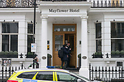 UNITED KINGDOM, London: 06 March 2018 A police officer re-directs a tourist outside of the Mayflower Hotel in Earls Court, London this afternoon after a Spanish tourist was found dead and a friend was found critically ill in their hotel room. It has been reported that a high level of gas was found in their room. Rick Findler / Story Picture Agency