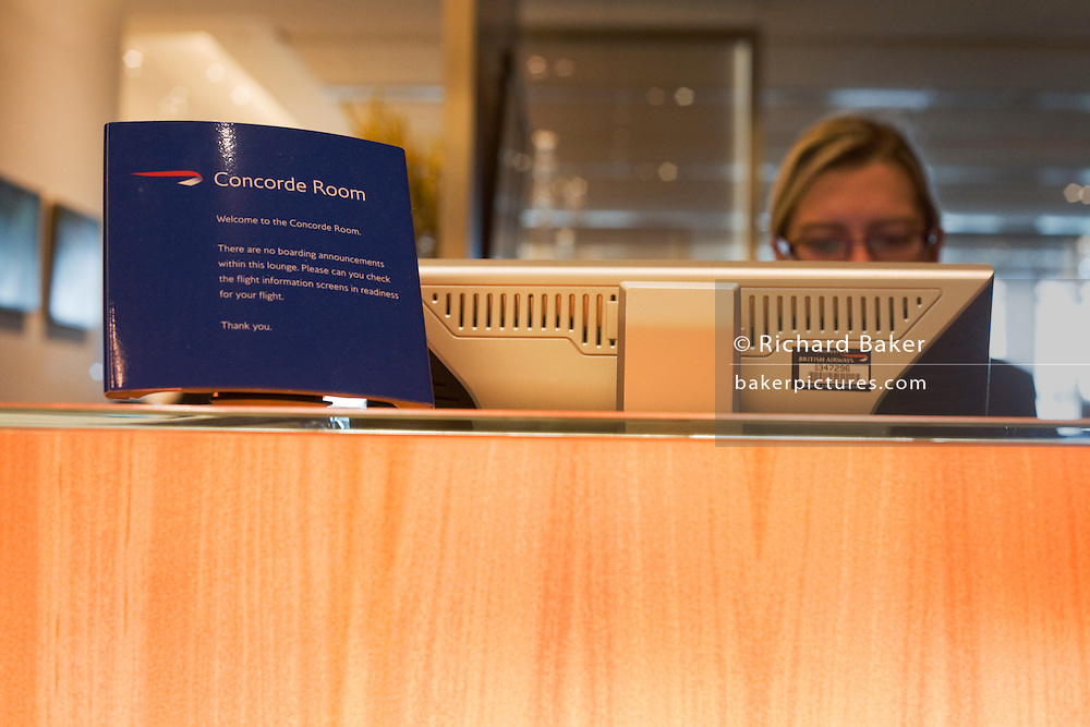 Receptionist in the British Airways Concorde Room for First Class passengers at Heathrow airport's terminal 5.