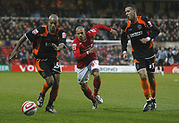 Photo: Richard Lane/Richard Lane Photography. Nottingham Forest v Blackpool. Coca Cola Championship. 13/12/2008. Alex Baptiste (L), Nathan Tyson (C) and Liam Dickinson (R) chase the ball