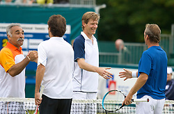 Liverpool, England - Friday, June 15, 2007: Mansour Bahrami and Peter Fleming shake hands with Cedric Pioline and Peter McNamara during the Legends Doubles on day four of the Liverpool International Tennis Tournament at Calderstones Park. For more information visit www.liverpooltennis.co.uk. (Pic by David Rawcliffe/Propaganda)