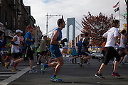 Participants run in Bay Ridge with the Verranzano Bridge in the background as they run in the New York City Marathon in Brooklyn, NY on Sunday, Nov. 3, 2013.<br /> <br /> CREDIT: Andrew Hinderaker for The Wall Street Journal<br /> SLUG: NYSTANDALONE