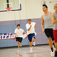 111412       Cable Hoover<br /> <br /> The Miyamura Patriots sprint down court in conditioning drills during basketball practice at Miyamura High School Wednesday.