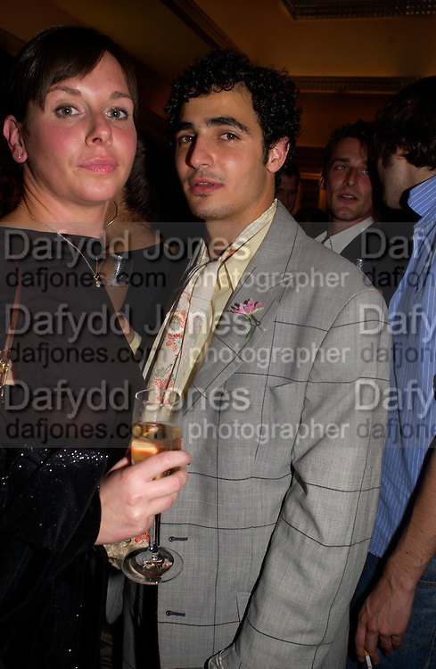 Joanna Jeffries and Zac Posen, Sean Ellis and Tagheuer host party to launch the photo book, 365: Ayear in fashion, Claridge's Bar. 20 May 2003. © Copyright Photograph by Dafydd Jones 66 Stockwell Park Rd. London SW9 0DA Tel 020 7733 0108 www.dafjones.com