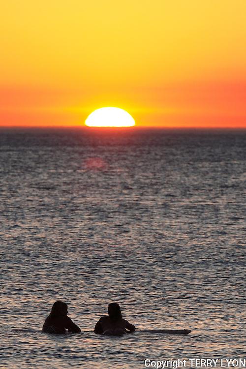 Girls enjoy champagne at sunset cottesloe beach Western Australia