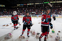 KELOWNA, CANADA - DECEMBER 2: Nolan Foote #29 Kyle Topping #24 and Cal Foote #25 of the Kelowna Rockets celebrate a goal that triggers the annual teddy bear toss against the Kootenay Ice on December 2, 2017 at Prospera Place in Kelowna, British Columbia, Canada.  (Photo by Marissa Baecker/Shoot the Breeze)  *** Local Caption ***