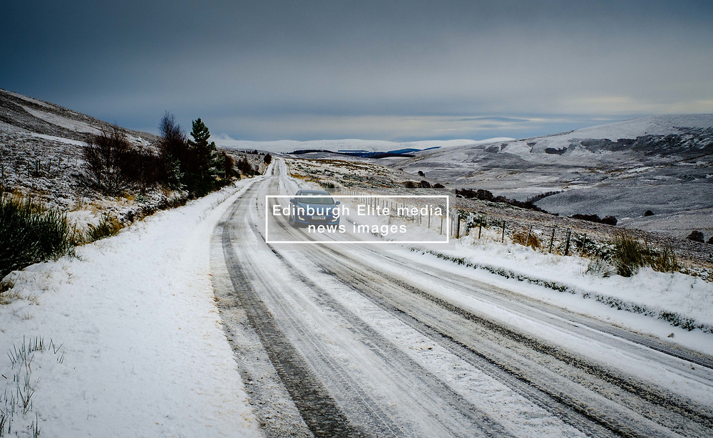 A car makes its way carefully along the A939 near Tomintoul, Highlands of Scotland.  At 1400 feet above sea level it is one of the highest roads in Scotland.<br /> <br /> (c) Andrew Wilson | Edinburgh Elite media