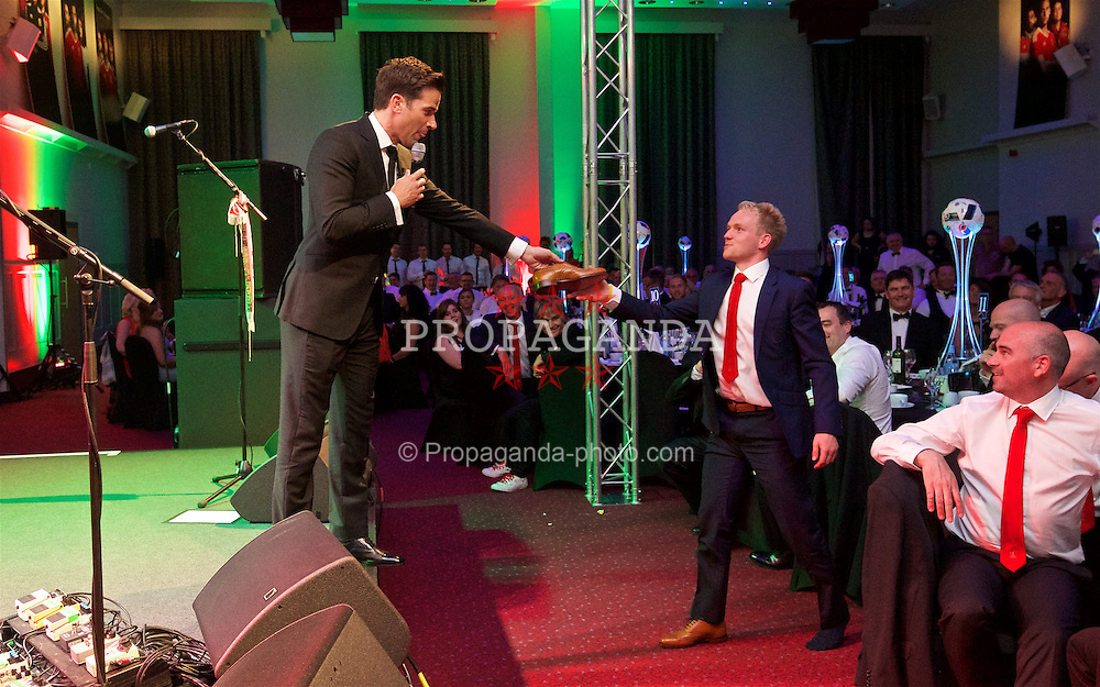 CARDIFF, WALES - Wednesday, June 1, 2016: Wales' Jonathan Williams is given his shoe back by host Gethin Jones during a charity send-off gala dinner at the Vale Resort Hotel ahead of the UEFA Euro 2016. (Pic by David Rawcliffe/Propaganda)