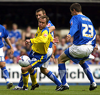 Fotball<br /> Foto: SBI/Digitalsport<br /> NORWAY ONLY<br /> <br /> Ipswich Town v Cardiff City<br /> Coca Cola Championship.<br /> 06/08/2005.<br /> <br /> Kevin Cooper of Cardiff is tackled by Matt Richards left and Owen Garvan of Ipswich
