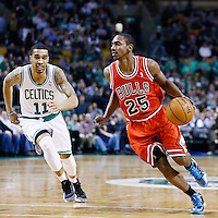 13 February 2013: Chicago Bulls point guard Marquis Teague (25) drives past Boston Celtics shooting guard Courtney Lee (11) during the Boston Celtics 71-69 victory over the Chicago Bulls at the TD Garden, Boston, Massachusetts, USA.