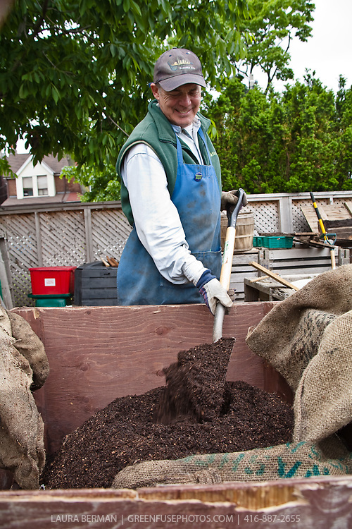 Master Composter Mike Nevin mixes a batch of his high quality screened compost.