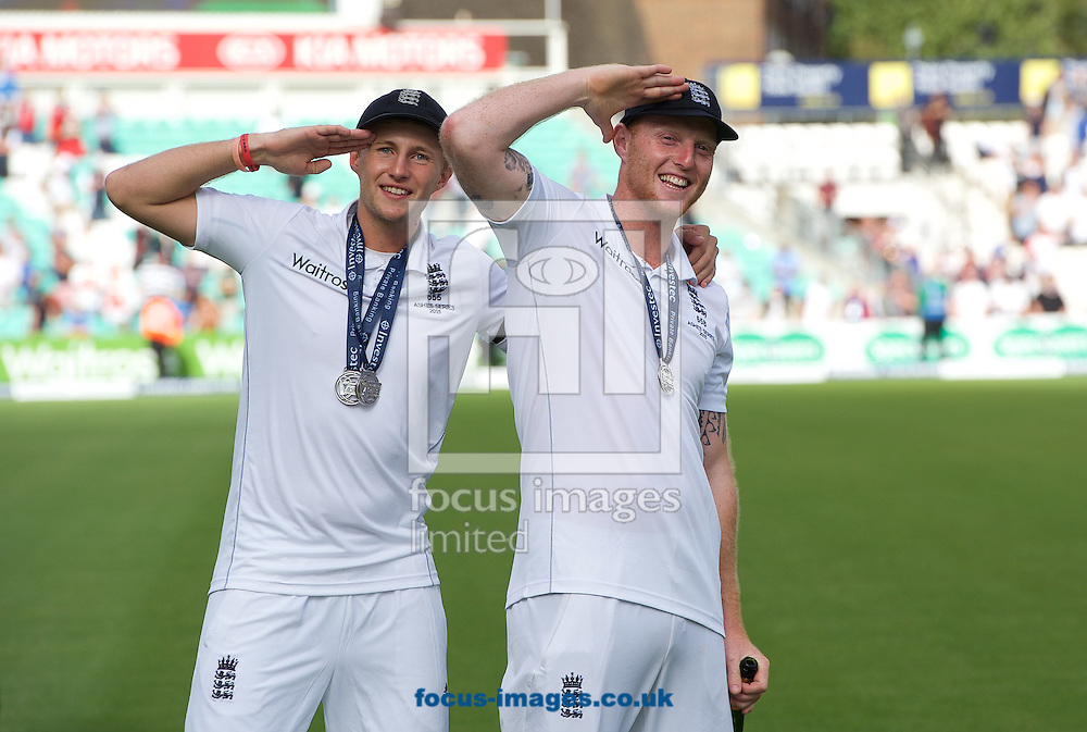 Joe Root of England and Ben Stokes (right) salute the fans after winning the Ashes series during the 5th Investec Ashes Test match at the Kia Oval, London<br /> Picture by Alan Stanford/Focus Images Ltd +44 7915 056117<br /> 23/08/2015