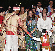 ASSAM, April 13, 2016 <br /> <br /> Duke and Duchess of Cambridge tour of India<br /> <br /> Britain's Prince William (1st R, 2nd row) and his wife Kate Middleton (2nd R, 2nd row) interact with a little Assamese traditional Bihu dancer at Diphlu River Lodge in the Kaziranga National Park, Indian northeastern Assam state, April 12, 2016. The couple visited the world heritage site which is the home to two-thirds of the world's Indian one-horned rhinos during their royal tour in India. <br /> ©Exclusivepix Media