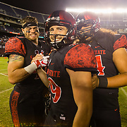 22 September 2018: San Diego State Aztecs place kicker John Baron II (29) is congratulated by teammates after hitting a 38 yard field goal in overtime. The San Diego State Aztecs beat the Eastern Michigan Eagles 23-20 in over time at SDCCU Stadium in San Diego, California.