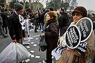 "Rally members, remembering the death of editor-in-chief of the bilingual Turkish-Armenian newspaper Agos, Hrant Dink, wore scarves and held placards stating ""We are all Hrant, We are all Armenian""."
