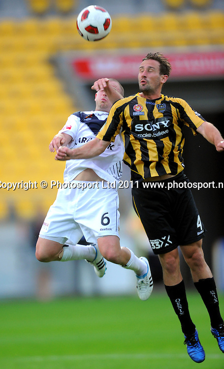 Phoenix' Nick Ward competes for the ball with Leigh broxham. A-League football - Wellington Phoenix v Melbourne Victory at Westpac Stadium, Wellington, New Zealand on Wednesday, 5 January 2011. Photo: Dave Lintott/PHOTOSPORT