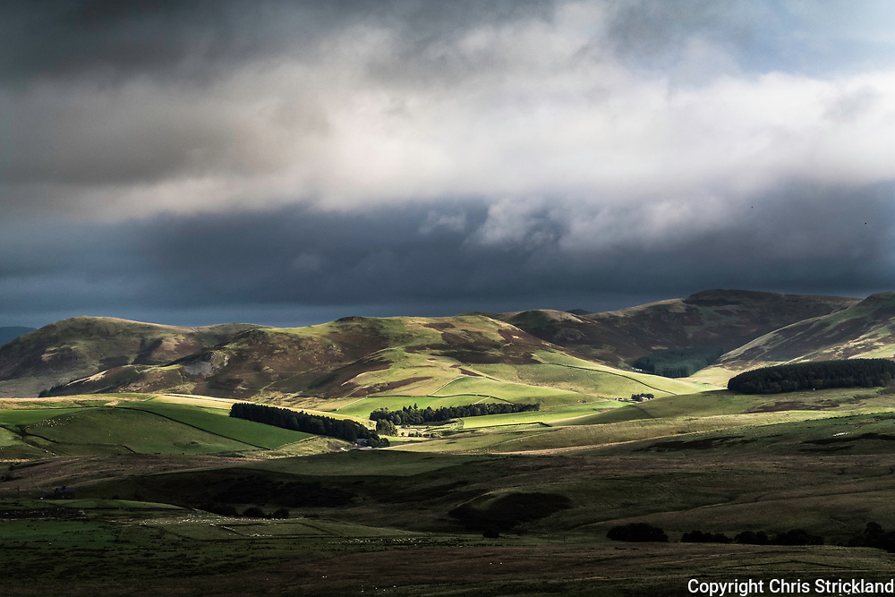 Hindhope farm in the Cheviot Hills viewed from Catcleugh on the Anglo Scottish Border.