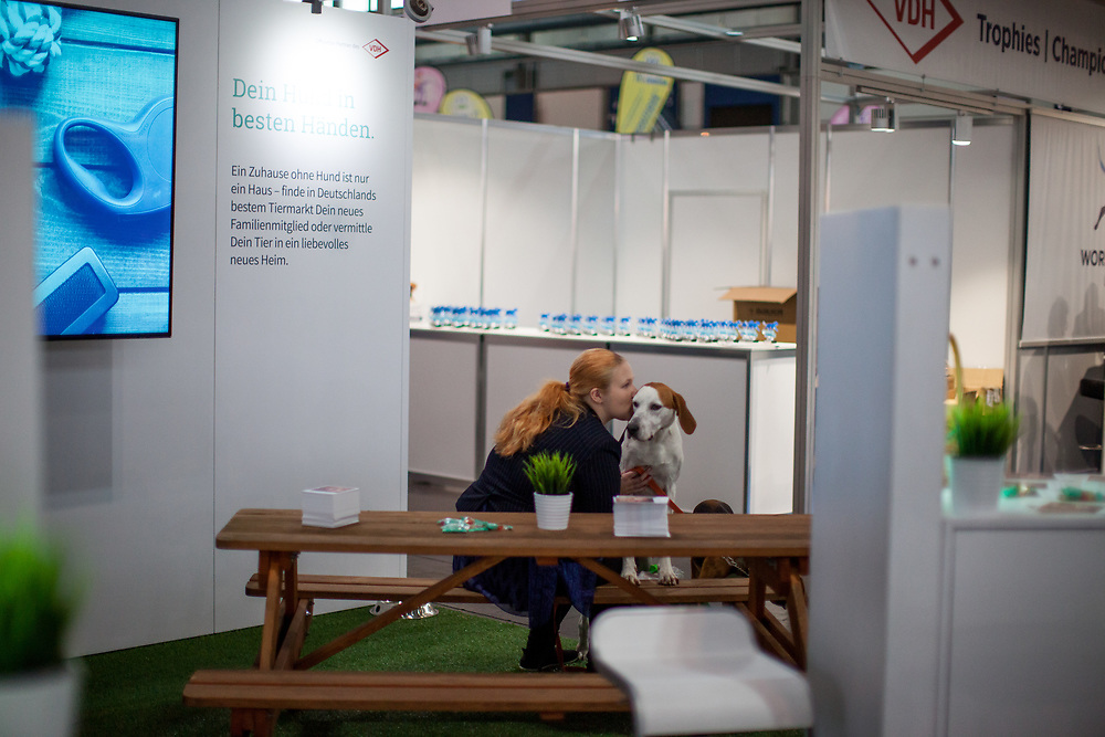 Woman kissing her dog at the stand of VDH, the organiser of the World Dog exhibition at the Leipzig Trade Fair. Over 31,000 dogs from 73 nations will come together from 8-12 November 2017 in Leipzig for the biggest dog show in the world.