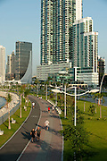 People walking at Cinta Costera pedestrian paths. Panama City, Panama, Central America.