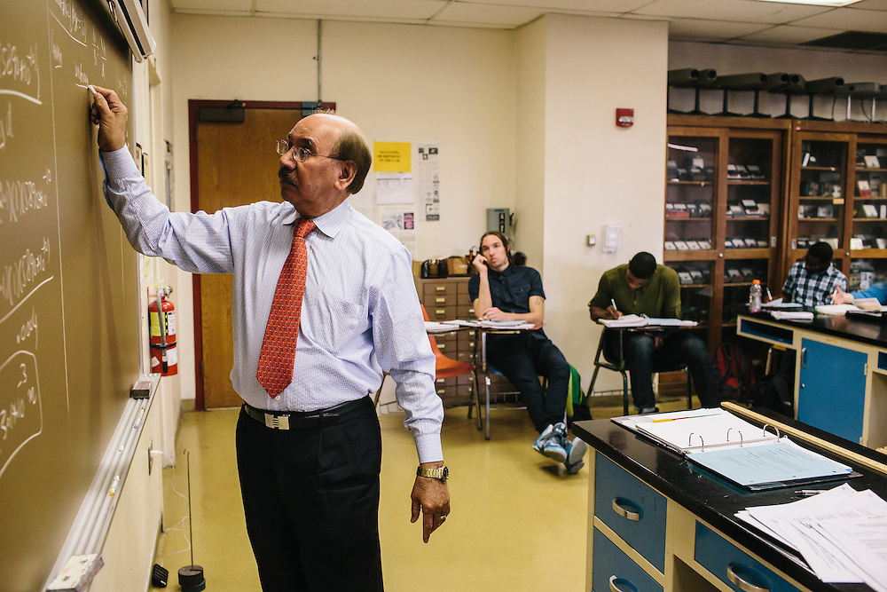 Dr. Daryao Khatri, a professor at University of Washington DC, teaches a physics class on Thursday, April 9, 2014. Dr. Khatri uses a variety of different methods to teach physics to students, including forgoing the standard textbook and instead giving students binders full of his lessons.