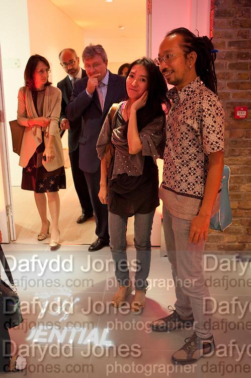 Ay Tjoe Christine: Angki Purbandono, Indonesian Eye Contemporary Art Exhibition Reception, Saatchi Gallery. London. 9 September 2011. <br /> <br />  , -DO NOT ARCHIVE-&copy; Copyright Photograph by Dafydd Jones. 248 Clapham Rd. London SW9 0PZ. Tel 0207 820 0771. www.dafjones.com.