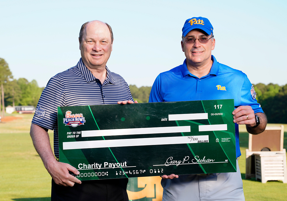 Peach Bowl, Inc. CEO & President Gary Stokan presents Pittsburgh head football coach Pat Narduzzi a check for his charity after the Chick-fil-A Peach Bowl Challenge at the Ritz Carlton Reynolds, Lake Oconee, on Tuesday, April 30, 2019, in Greensboro, GA. (Paul Abell via Abell Images for Chick-fil-A Peach Bowl Challenge)