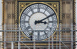 © Licensed to London News Pictures. 12/10/2017. London, UK. A scaffolder looks down from in front of a clock face on The Elizabeth Tower, known as Big Ben at Parliament. Scaffolding will reach a height of 96 meters when completed - the work is part of a three-year programme to conserve the Great Clock, the Elizabeth Tower and Big Ben. London, UK. Photo credit: Peter Macdiarmid/LNP