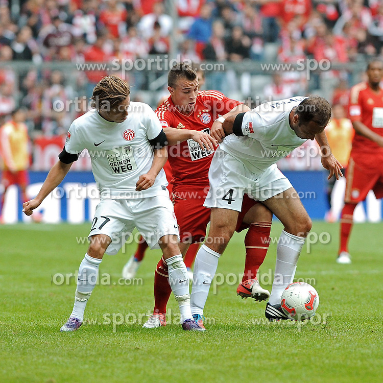 15.09.2012, Allianz Arena, Muenchen, GER, 1. FBL, FC Bayern Muenchen vs 1. FSV Mainz 05, 03. Runde, im Bild Xherdan SHAQIRI (FC Bayern Muenchen) will sich gegen Nicolai MUELLER (1.FSV Mainz 05),links und Nikolce NOVESKI (1.FSV Mainz 05) durchsetzen. // during the German Bundesliga 03rd round match between FC Bayern Munich and 1. FSV Mainz 05 at the Allianz Arena, Munich, Germany on 2012/09/15,, , , , . EXPA Pictures © 2012, PhotoCredit: EXPA/ Eibner/ Wolfgang Stuetzle..***** ATTENTION - OUT OF GER *****