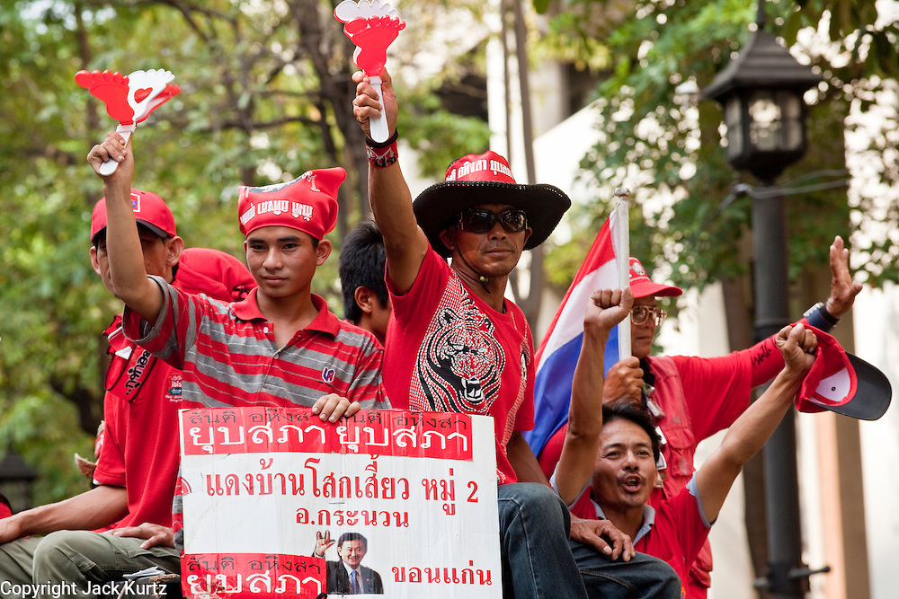 """Apr 4, 2010 - BANGKOK, THAILAND: Red Shirts arrive at Ratchaprasong intersection in a motorcade, Sunday, Apr. 4. Thousands of members of the United Front of Democracy Against Dictatorship (UDD), also known as the """"Red Shirts"""" and their supporters moved their anti government protests into central Bangkok Apr. 4 when they occupied Ratchaprasong intersection, the site of Bangkok's fanciest shopping malls and several 5 star hotels. The Red Shirts are demanding the resignation of current Thai Prime Minister Abhisit Vejjajiva and his government. The protest is a continuation of protests the Red Shirts have been holding across Thailand. They support former Prime Minister Thaksin Shinawatra, who was deposed in a coup in 2006 and went into exile rather than go to prison after being convicted on corruption charges. Thaksin is still enormously popular in rural Thailand. This move, away from their traditional protest site in the old part of Bangkok, has gridlocked the center of the city and closed hundreds of stores and restaurants and several religious shrines. There has not been any violence, but the government had demanded that the Red Shirts return to the old part of the city.   PHOTO BY JACK KURTZ"""