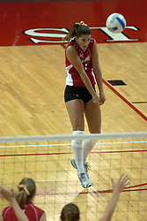 09 OCT 2005 Redbirds Savannah Knowles saves a point and passes to the front. The Illinois State University Redbirds hosted arch rival Bradley University Braves.  The Redbirds soared over the Braves, taking the match in 4 games, losing only game number 2.  Action included play by Braves Star Lindsey Stalzer who is ranked no. 7 in the nation in kills per game.  The first defeat of the conference season for the Braves took place at Redbird Arena on Illinois State's campus in Normal IL.