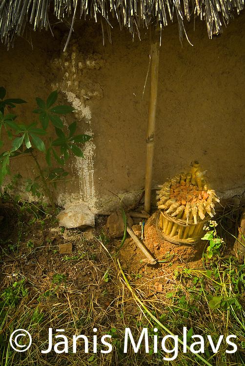 Sacred fetish besides white marking on the hut wall in Bedik village, Senegal, West Africa.