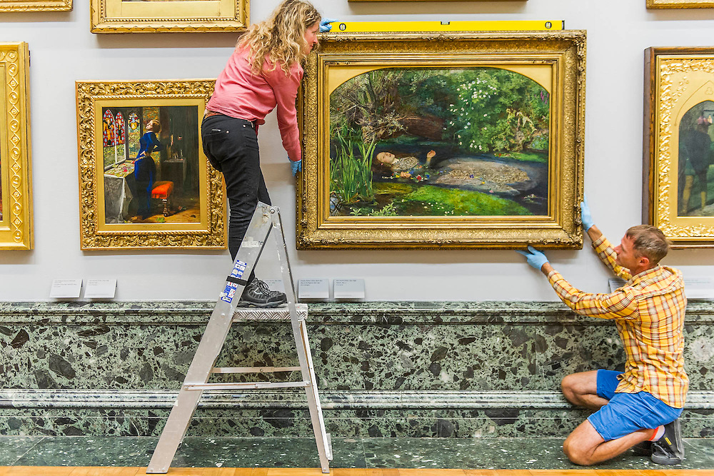 The return and re-hanging of the nation&rsquo;s Pre-Raphaelite works, including Millais&rsquo; Ophelia (pictured right), to Tate Britain. They are going back on display from Thursday 7 August 2014 after being seen by over 1.1 million people worldwide. They include: John Everett Millais&rsquo; , Ophelia; Beata Beatrix by Dante Gabriel Rossetti; The Lady of Shalott by John William Waterhouse ; The Beloved by Rossetti; and Mariana  (pictured left)  by John Everett Millais. These works are being displayed in the 'grand' surroundings of the 1840 galleries as part of the BP Walk through British Art. <br /> Millbank,  London, UK.
