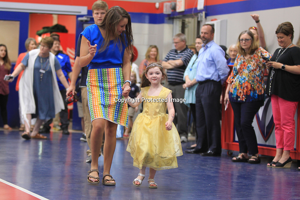 """Abby Boren, the Make-A-Wish Community Leader and a senior at TCPS, walks in the school's gym, with Azie Leathers, 5, of Tremont, dressed as Belle, from the Disney movie """"Beauty and the Beast"""", prior to her Make-A-Wish dreams coming true with a trip to Disney World Wednesday morning at TCPS in Tupelo."""