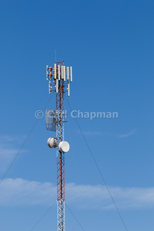 Antennas for rural cellular, microwave and communications  mobile telephone system on a triangular lattice tower in country Findley, News South Wales, Australia.