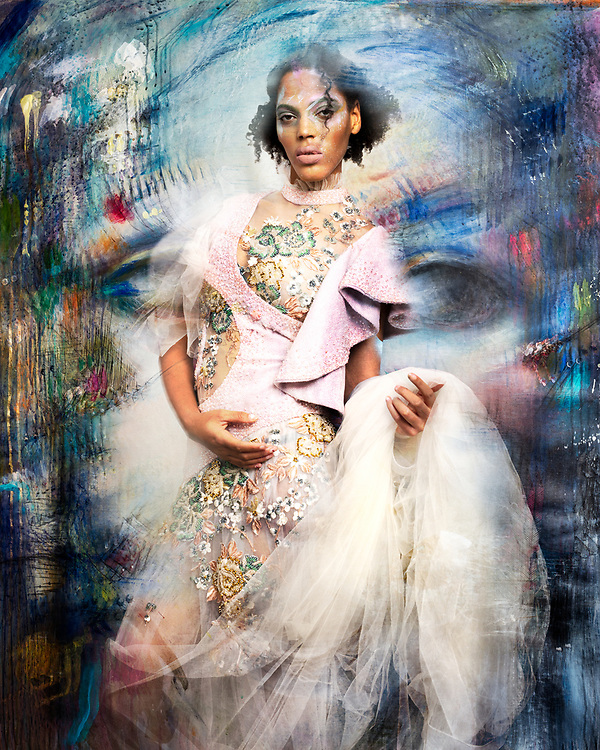 Surreal dream image made by composit of a model in a couture dress and an expressionist painting of a female face.