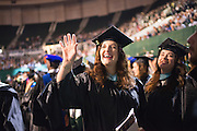 Allyson Natalie Hays waves to family and friends at graduate commencement. Photo by Ben Siegel