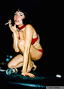 Woman crouching smoking a cigarette Ibiza 1999
