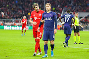 Bayern Munich defender Javi Martínez (8) has words with Tottenham Hotspur midfielder Christian Eriksen (23) during the Champions League match between Bayern Munich and Tottenham Hotspur at Allianz Arena, Munich, Germany on 11 December 2019.