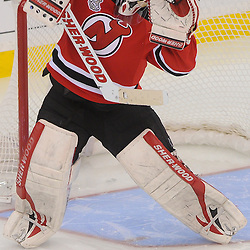June 2, 2012: New Jersey Devils goalie Martin Brodeur (30) fights off a high shot during overtime action in game 2 of the NHL Stanley Cup Final between the New Jersey Devils and the Los Angeles Kings at the Prudential Center in Newark, N.J. The Kings defeated the Devils 2-1 in overtime.