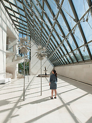 Woman in Sculpture Hall at Modern Art Museum MUDAM Musee d'Art Moderne Grand Duc Jean  Luxembourg
