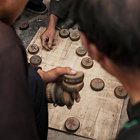 Chinese chess played on the street in Yellow Sheep River, Gansu Province, China.