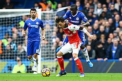 Mesut Ozil of Arsenal is tackled by Ngolo Kante of Chelsea - Mandatory by-line: Jason Brown/JMP - 04/01/2017 - FOOTBALL - Stamford Bridge - London, England - Chelsea v Arsenal - Premier League