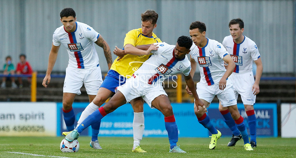 Luke Croll leads the defensive line during the Pre-Season Friendly match between St Albans FC and Crystal Palace at Clarence Park, St Albans, United Kingdom on 21 July 2015. Photo by Michael Hulf.