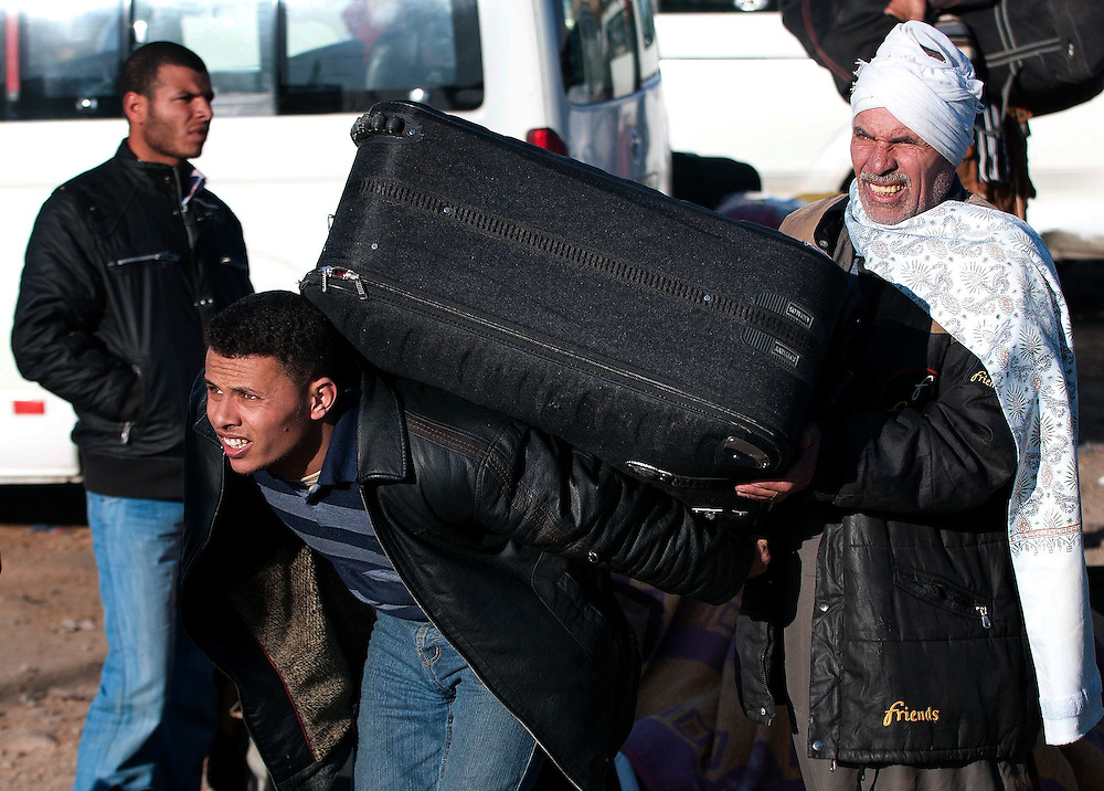 Refugees flee Libya for Egypt. Many have only recently made it though to the Egyptian side of the border.