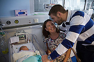 Philip and Kathryn Jones from Canterbury, Kent, pictured with their three-day-old son Finn at the Evelina London Children's Hospital neonatal intensive care unit in central London. Their son was born with a pre-diagnosed condition which required a life-saving, five-hour heart 'switch' operation to be carried out within the first two weeks of his life. The operation, which took place when Finn was 10 days old was successful, however, due to other near fatal complications the his recovery during the subsequent six weeks was slow and difficult.