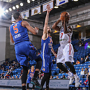 Delaware 87ers Guard JUWAN STATEN (7) drives under the basket as Westchester Knicks Forward DARION ATKINS (5) and Westchester Knicks Center JORDAN BACHYNSKI (34) defends in the first half of a NBA D-league regular season basketball game between the Delaware 87ers and the Westchester Knicks Tuesday, JAN, 19, 2016 at The Bob Carpenter Sports Convocation Center in Newark, DEL